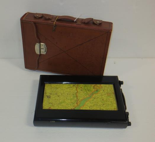 A leather-cased scrolling travelling map, 1920s,