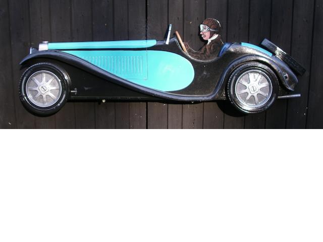 A hand-painted wooden profile of a Bugatti Type 55,
