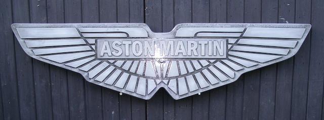 An 'Aston Martin' garage display emblem,