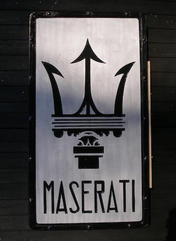 A 'Maserati' garage display emblem,