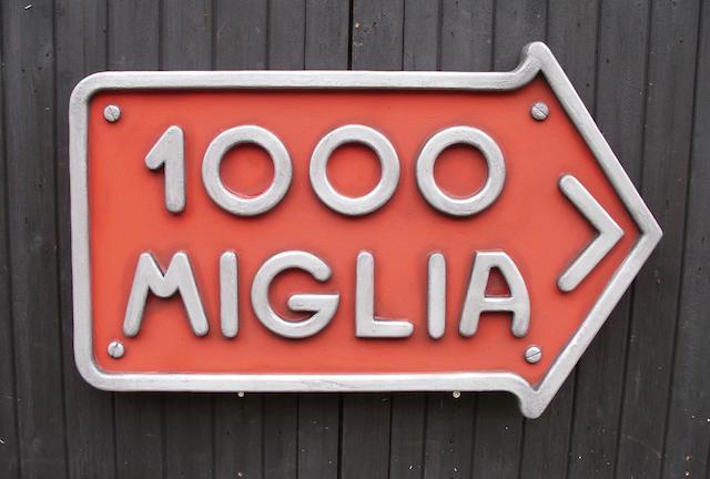A 'Mille Miglia' garage display sign,
