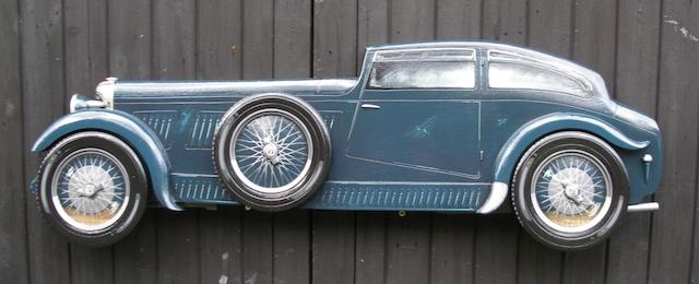 A hand-painted wooden profile of the 'Blue Train' Bentley,