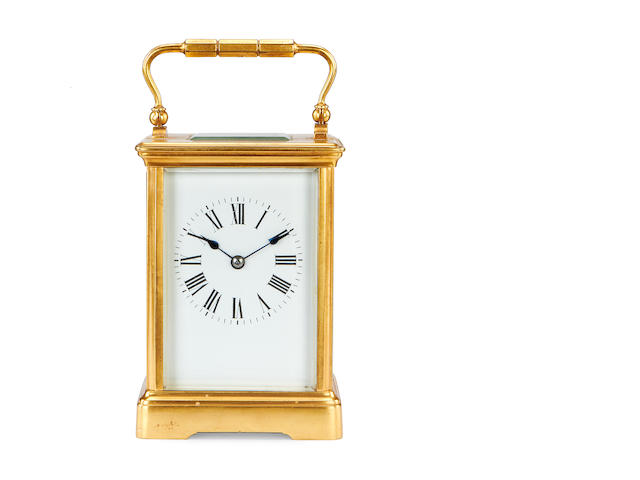 A late 19th / early 20th century French gilt brass carriage clock