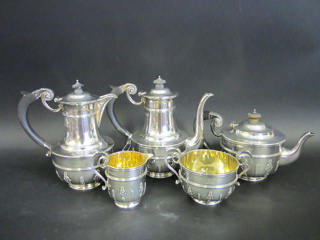 An Edwardian and later silver five piece tea and coffee service by Elkington & Co., London 1908/13