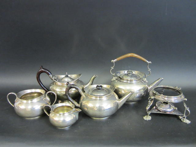 A Victorian silver three piece baluster tea service by Hukin & Heath, Birmingham 1878
