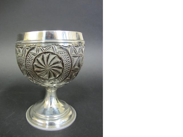 A George III silver mounted carved coconut goblet by George Gray, London 1783