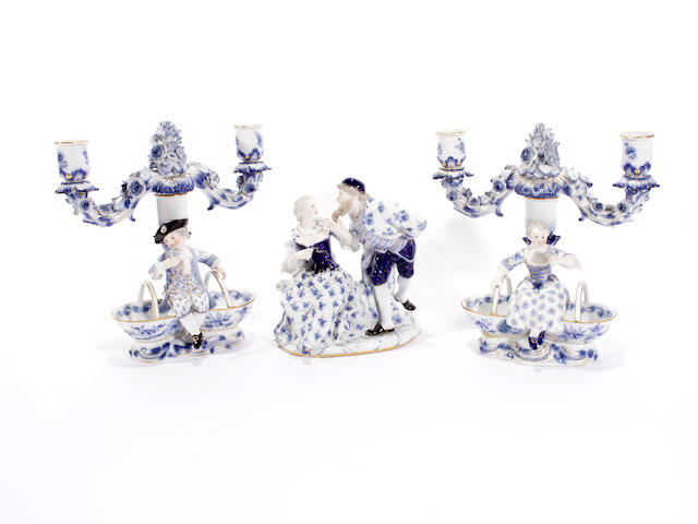 Pair Meissen candlesticks and a figure group