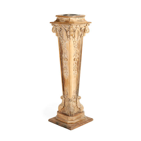 An early 20th century carved and stripped pine pedestal