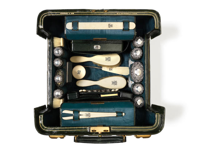 A late 19th Century  green Moroccan leather  Gladstone-style vanity case with ivory mounted dressing table set, retailed by Leuchars & Son of Piccadilly, London; together with a brown Morrocan leather case (Qty)