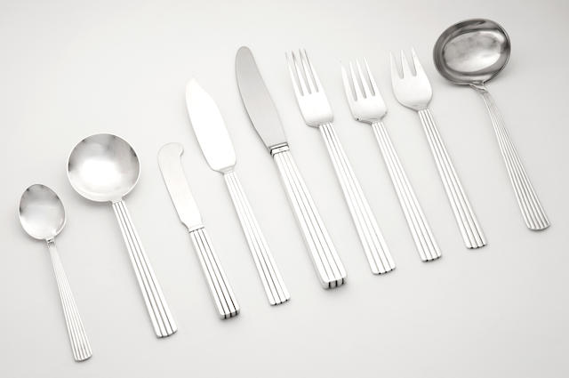 Georg Jensen; A silver Bernadotte pattern table service of flatware stamped Georg Jensen (incuse lettering), Sterling, Denmark, the table knife blades stamped Georg Jensen, Denmark, Stainless Steel