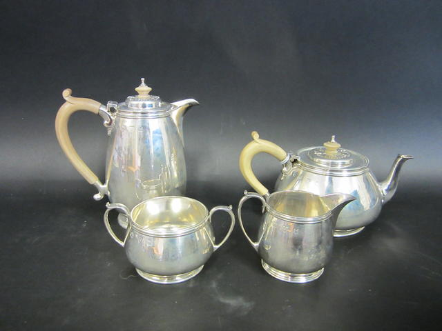 A silver four piece tea and coffee service by Lowes, Chester 1958