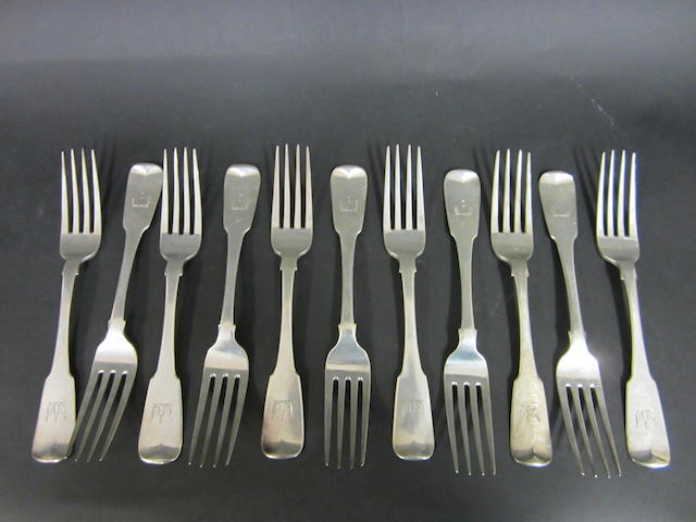 A George III silver set of eleven fiddle pattern table forks by Richard Whitford, Dublin 1814, retailed by M.West