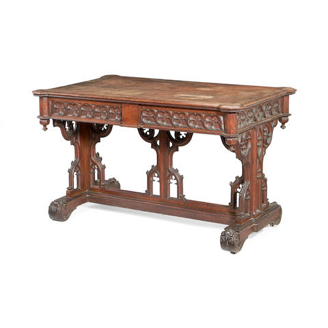 An early Victorian oak library centre table in the manner of Lewis Nockalls Cottingham
