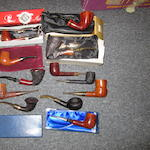 A collection of pipe smoking pipes: