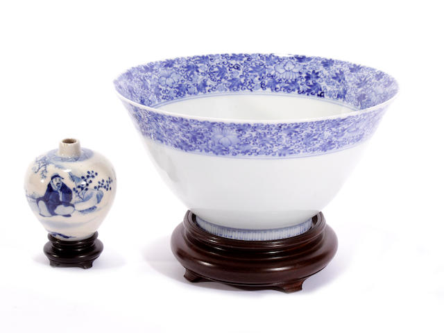 An underglaze blue and polychrome enamel bowl, and a small blue and white vase, latter with six-character Kangxi mark
