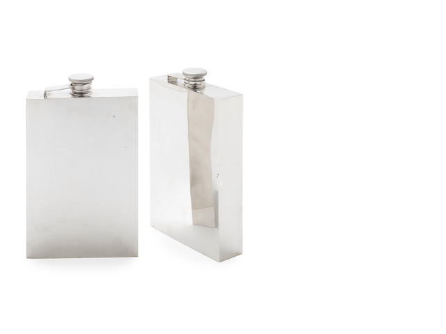 A pair of American silver hip flasks