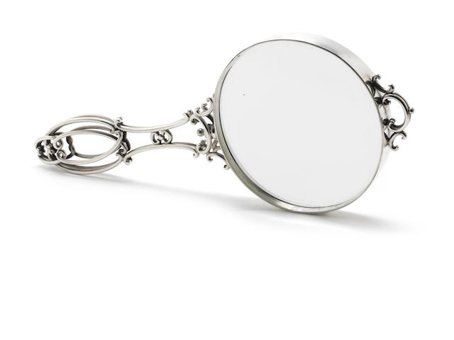 A  silver-mounted magnifying glass