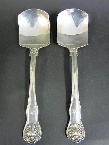 A George IV silver pair of King's husk with husk heel pattern ice cream spades by Charles Eley London 1828