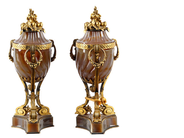 A pair of 19th Century French agate and ormulu mounted urns and covers