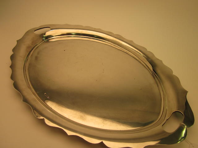 A silver oval two-handled tray, by Walker and Hall, Sheffield date letter worn