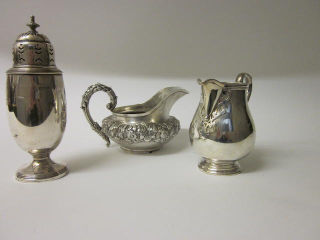 A William IV silver cream jug,  makers marks worn, London 1827,   (3)