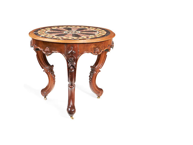 A mid Victorian specimen marble and carved walnut centre table