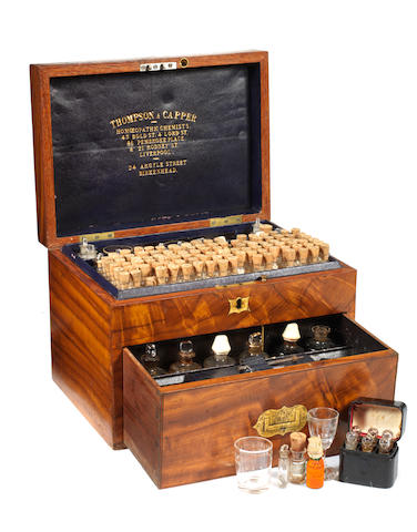 A Thompson & Capper walnut and tiger wood veneered homoeopathic chest,  English,  late 19th century,