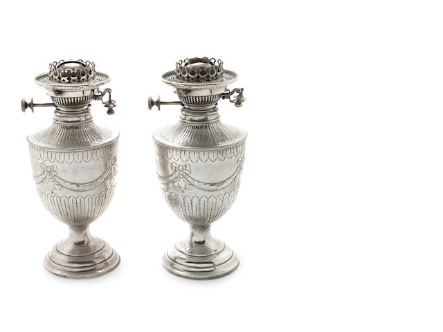 A pair of late Victorian silver lamp bases by James Deakin & Sons, Sheffield 1895, with patent No.65891  (2)