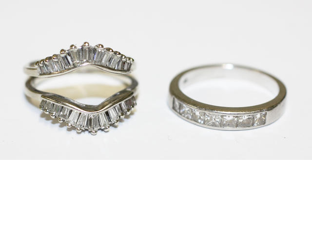Two diamond half hoop rings, (2)