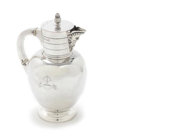 A  silver claret jug