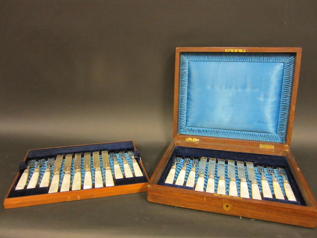 A Victorian silver and mother of pearl handled set of twelve pairs of dessert knives and forks by Archer, Machin and Marsh, Sheffield 1896