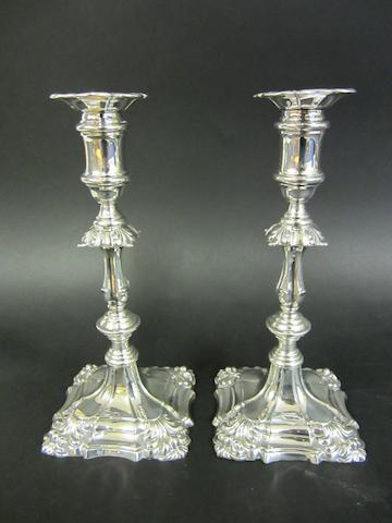 An Edwardian silver pair of baluster candlesticks by I.S. Greenberg, Birmingham 1903