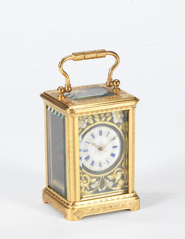 A late 19th century French engraved gilt brass miniature carriage timepiece