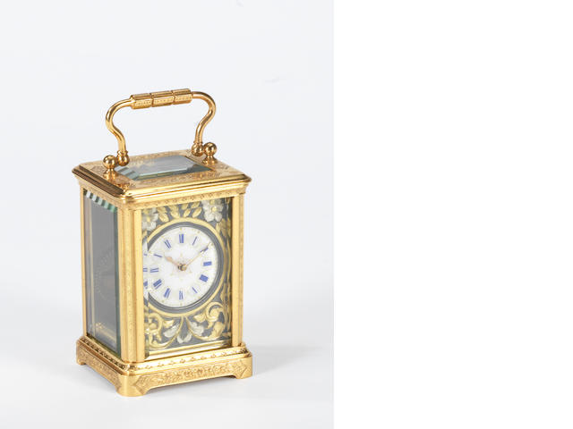 A late 19th century French engraved gilt brass miniature carriage timepiece.