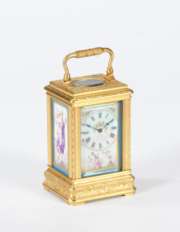 A late 19th century French porcelain mounted and engraved miniature carriage timepiece Drocourt