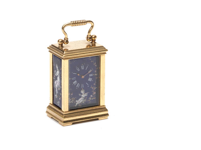 A late 19th century gilt brass and champleve enamel miniature carriage timepiece.