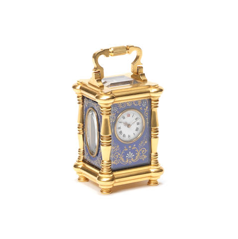 A late 19th century French gilt brass and enamel miniature carriage timepiece.
