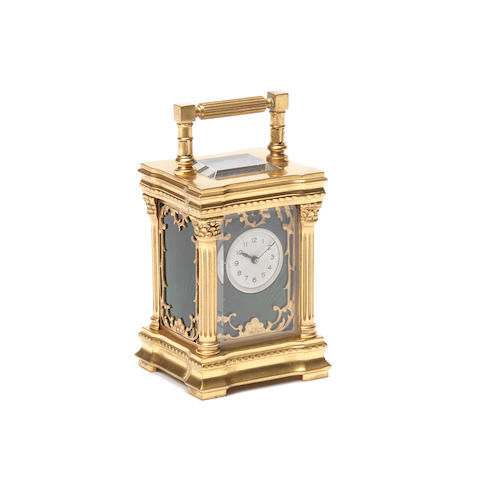 A late 19th century French brass miniature carriage timepiece