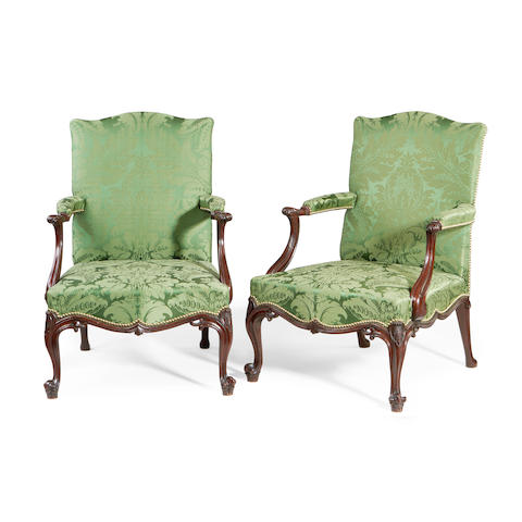 A pair of George III mahogany Gainsborough armchairs