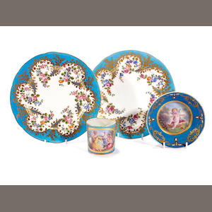 A Sèvres-style cabinet cup and saucer and a pair of outside decorated Sèvres plates, early 19th century and late 18th century