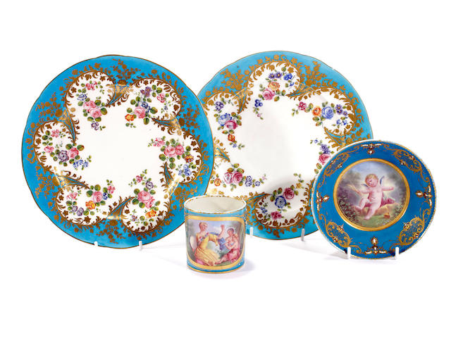 A Sèvres-style cabinet cup and saucer and a pair of outside decorated Sèvres plates, 19th century