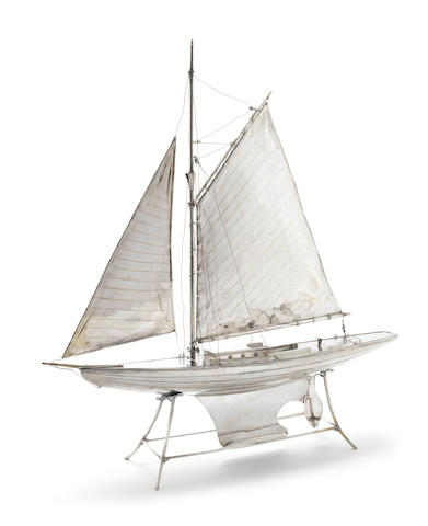 A  silver-plated model sailing boat