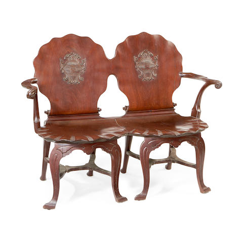 An Irish George III mahogany double chair back hall settee
