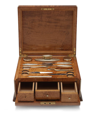 A   satinwood cased silver-gilt  dressing table set the silver-gilt mounts by H.A & Co, London 1911