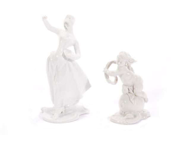 A Nymphenburg figure of a lady and another of a putto