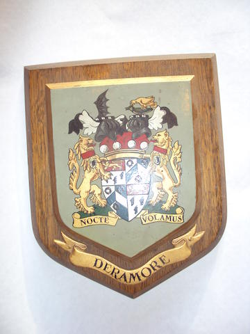 A 20th century oak shield-shaped plaque