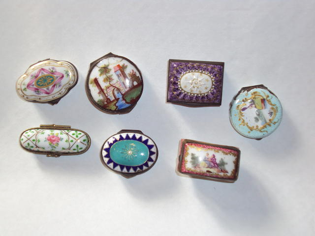 A group of seven enamel and porcelain pill boxes