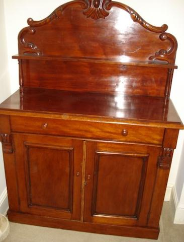 A Victorian mahogany chiffonier, the shaped shelved back on single drawer with twin cupboards doors on a plinth base, 110cm.