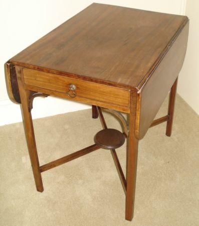 A George III mahogany Pembroke table, fitted with end frieze drawer on cross-stretchered supports, 94cm open.