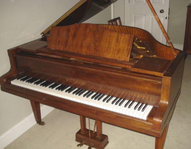 Bluthner:  a baby grand pianoforte, in mahogany case, on square tapered legs, cased stamped 'R13951', 155cm. (Purchased re-furbished within the past 2 years.)